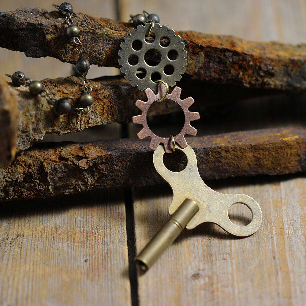 Vintage Clock Key with Replica Clock Parts Front