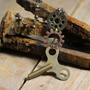 Vintage Clock Key with Replica Clock Parts Back