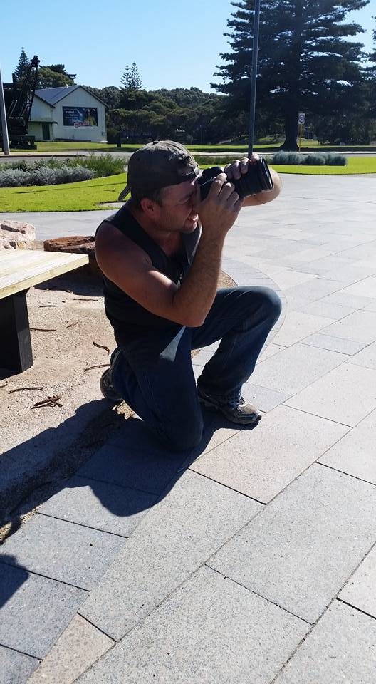 Andrew taking photo of Esperance whale tail.