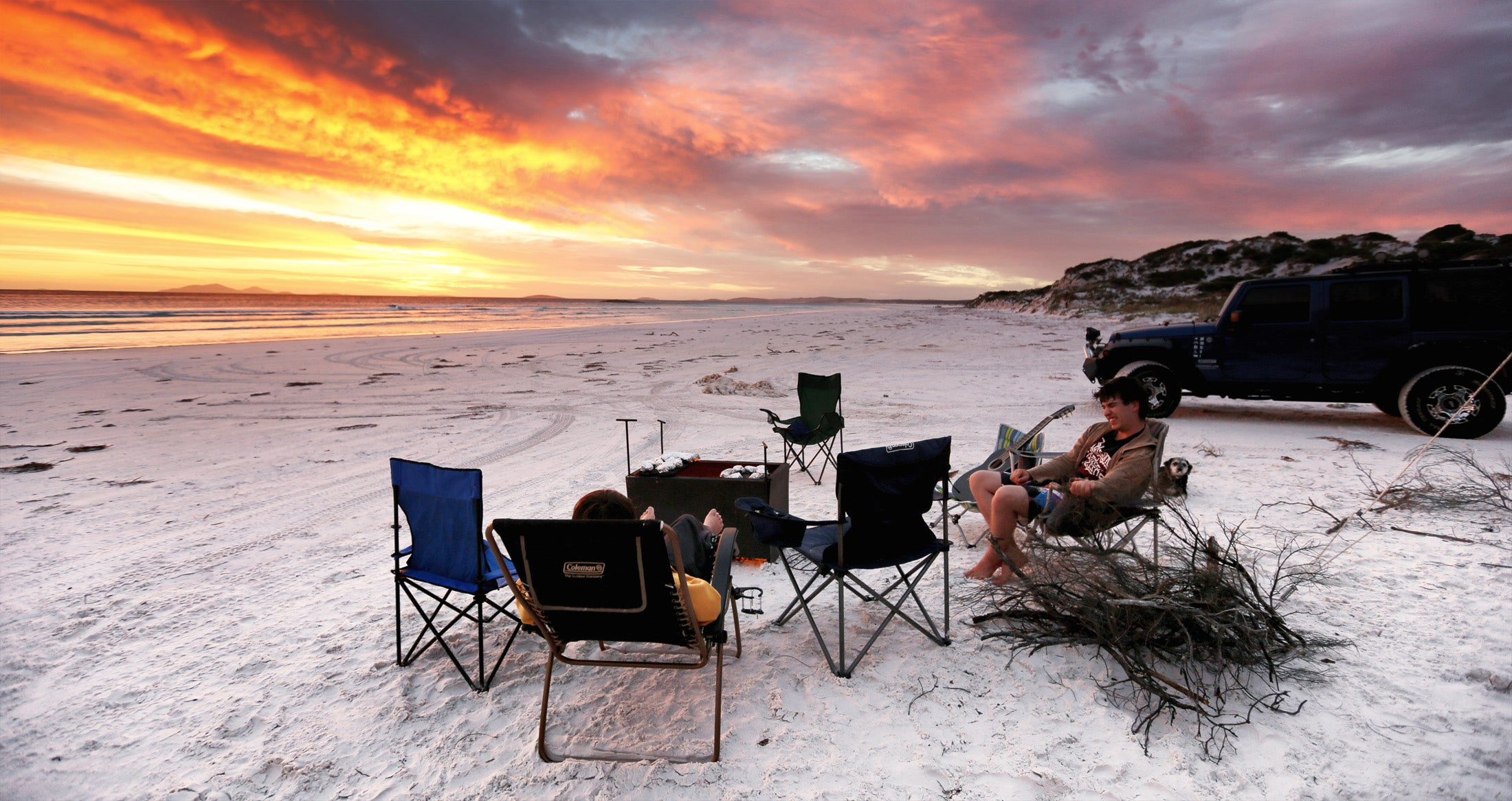 Beachside camping and campefires at night with an  Esperance Sunset.