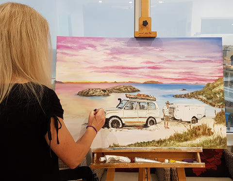 Tania Lowe working on commissioned painting of twilight cove
