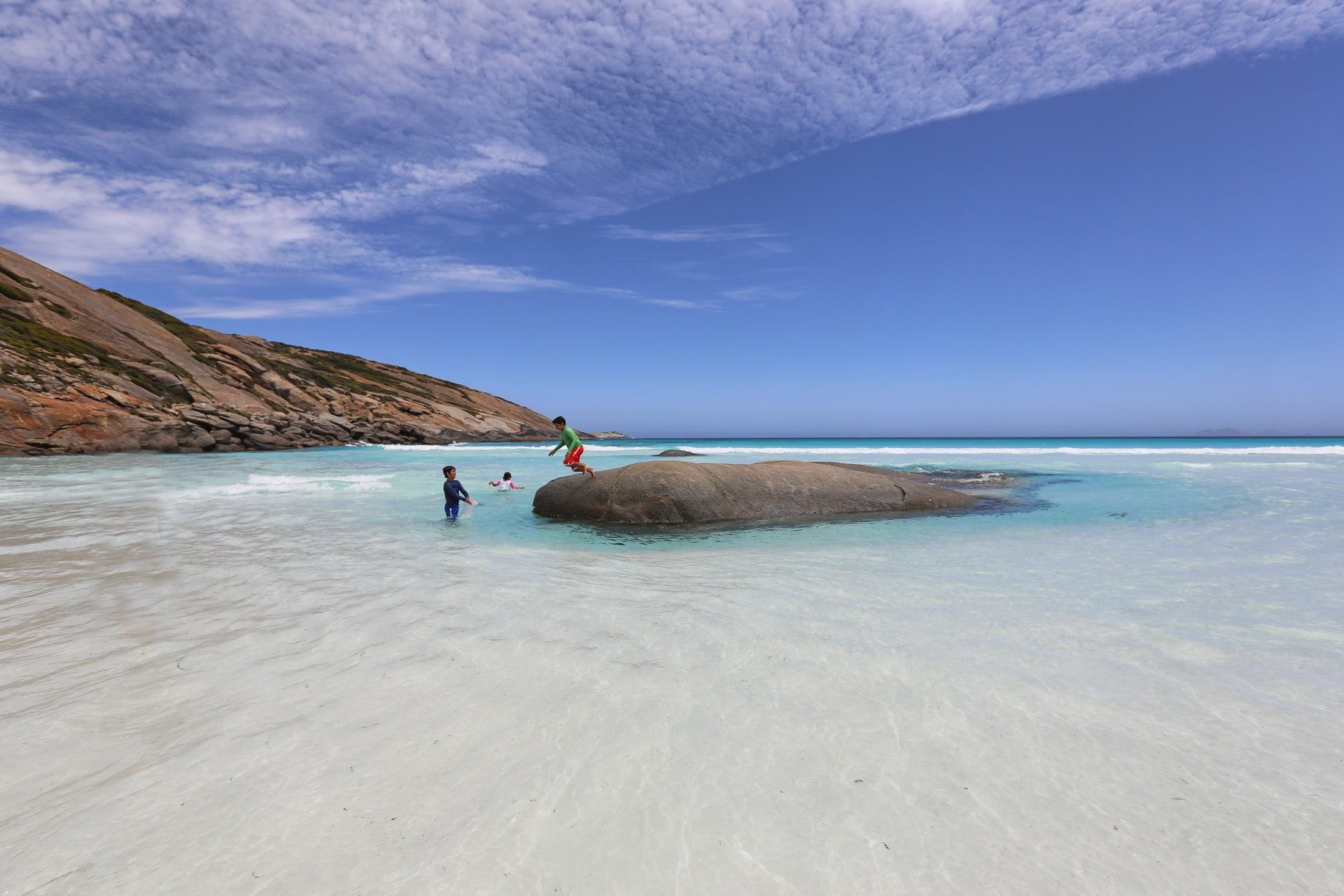 blue waters and a rock for kids to jump off - Esperance beaches at its best