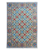 Blue and red hand-knotted Suzani tribal rug. Using natural vegetable dyes, our rugs are all unique and handmade. This high quality 100% wool rug has beautiful patterns and motifs, mixing modern with traditional