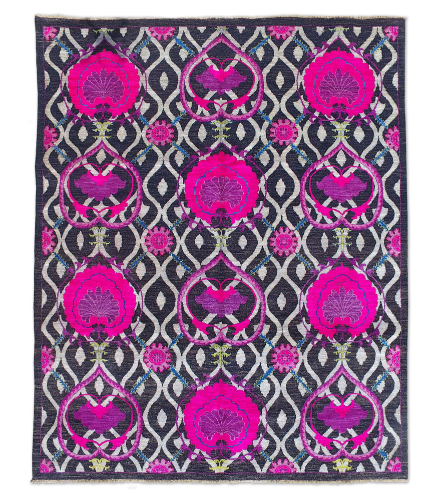Fuschia pink and black hand-knotted Suzani tribal rug. Using natural vegetable dyes, our rugs are all unique and handmade. This high quality 100% wool rug has beautiful patterns and motifs, mixing modern with traditional.