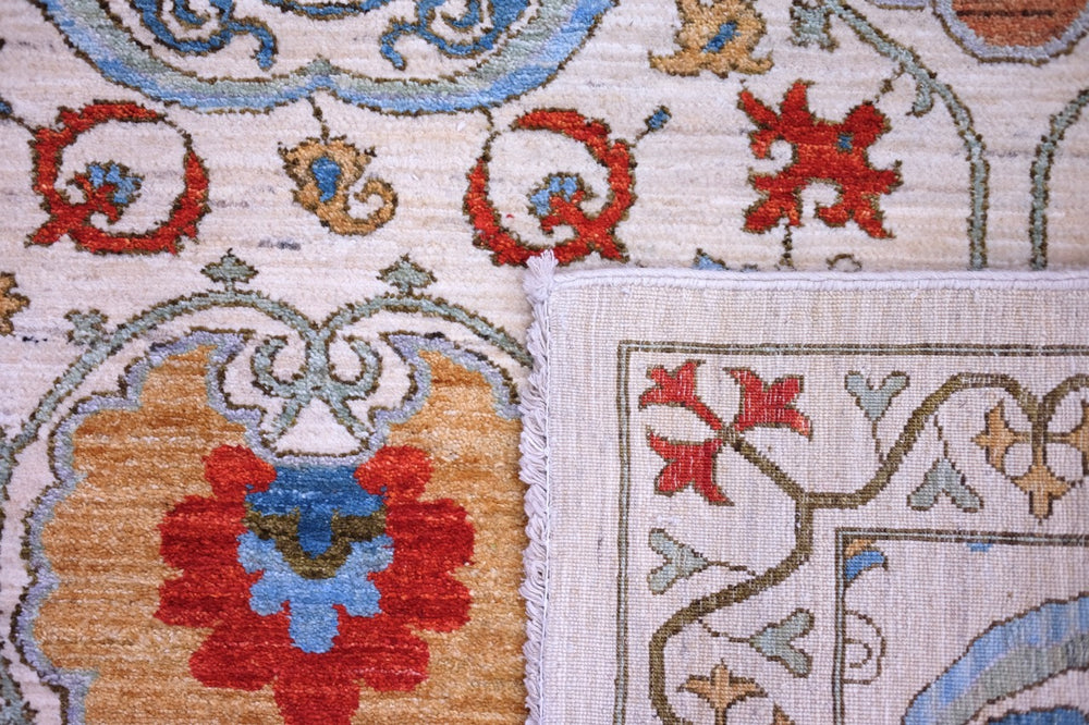Hand-knotted Suzani wool rug