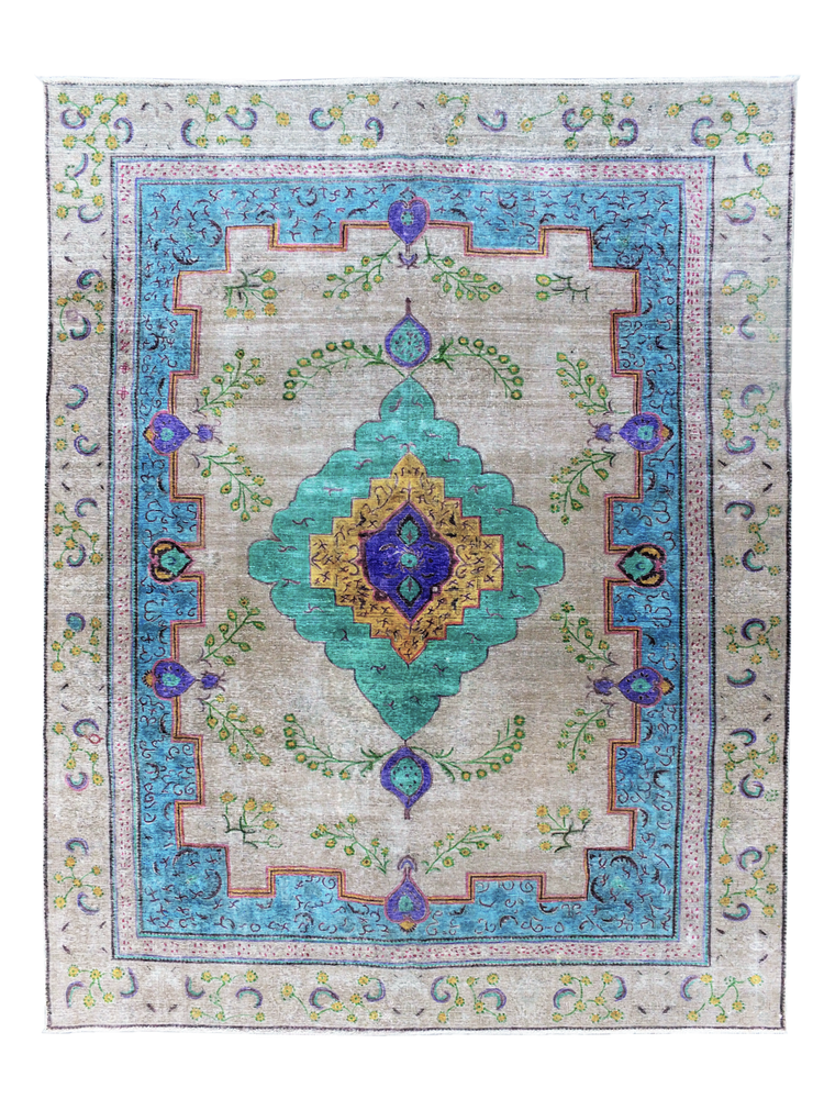 Multicoloured overdyed vintage Persian rug. Using natural dyes, our vintage rugs are all unique and handmade. This traditional 100% wool rug has intricate colourful patterns and motifs in vibrant blue, purple, yellow, green and cream