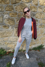 Grey Tie Waist Lounge Jumpsuit with burgundy bomber jacket