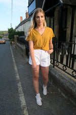 mustard knot front top and white shorts