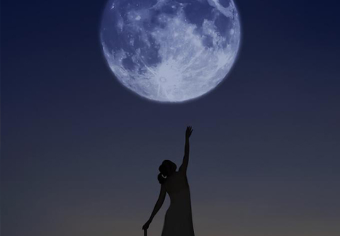 woman reaching for the moon