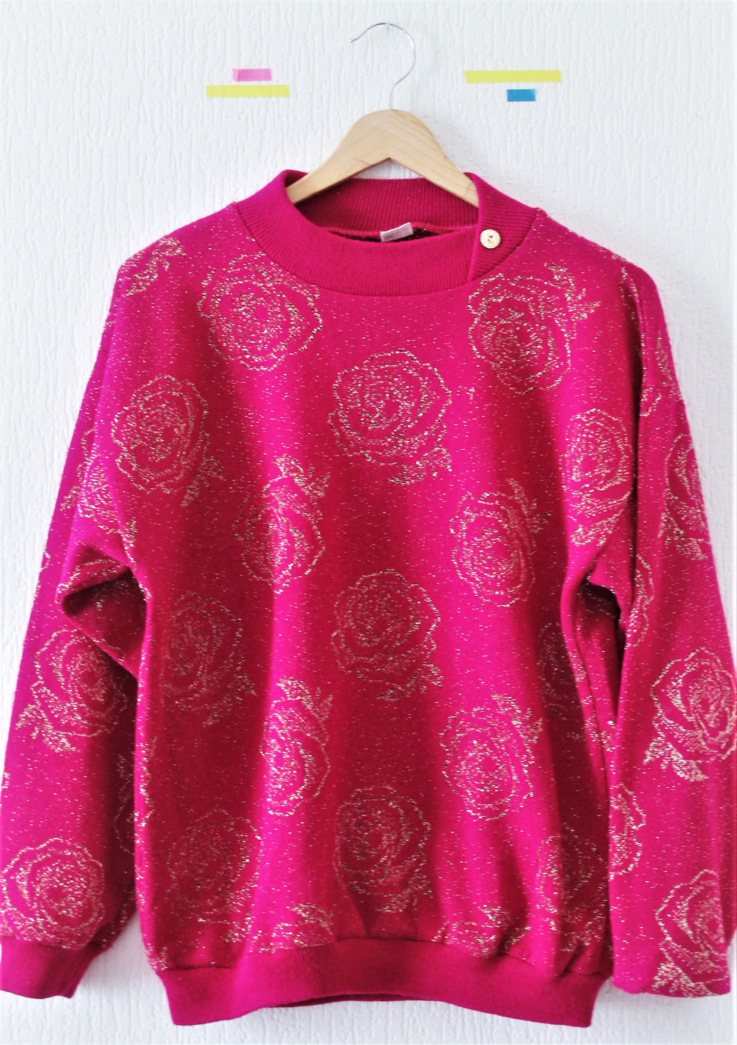 Pull rose pailleté