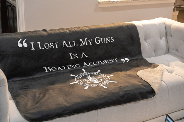 I lost all my guns in a boating accident sherpa throw blanket on couch