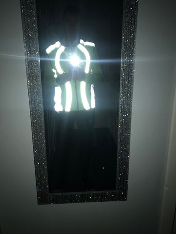 Customer website image shown in the dark with the bright reflecti really glowing - BTR high vis and Reflective Gilet