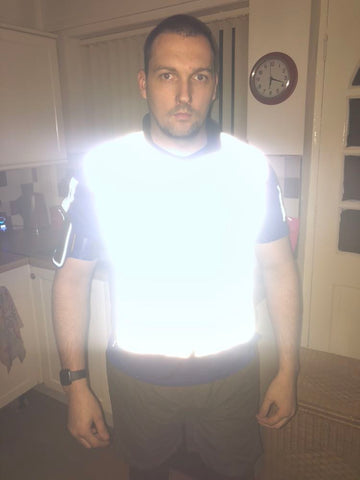 btr reflective cycling and running gilet being worn by a customer to demonstrate how high vis it is