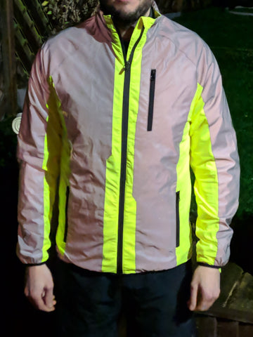 High vis & reflective cycling jacket shown worn , bright high vis
