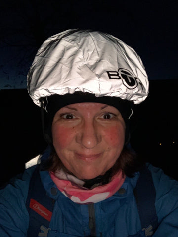 BTR high vis reflective bicycle helmet cover worn by lady in the evening