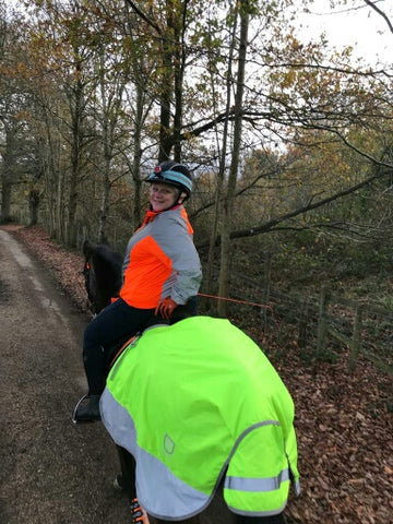BTR Jacket in orange and reflective silver shown worn by a horse rider - great for visibility!