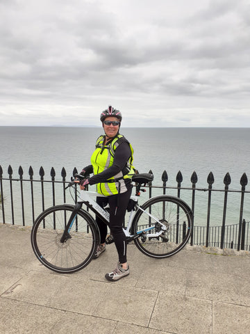 BTR high vis reflective gilet on a lady on a bicycle in Tenby seafront