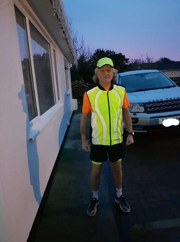 BTR high vis reflective running gilet worn by man in the evening