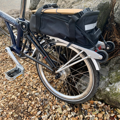 BTR Rear Rack Bicycle Pannier Bike Bag attached to Brompton Bicycle on a beach
