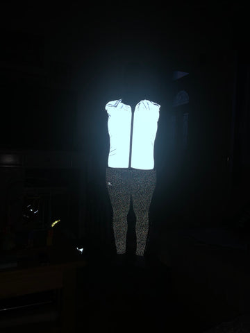 BTR Be Totally Reflective gilet shone over a motorbike jacket