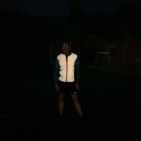 BTR reflective gilet worn by man in the dark demonstrating how reflective