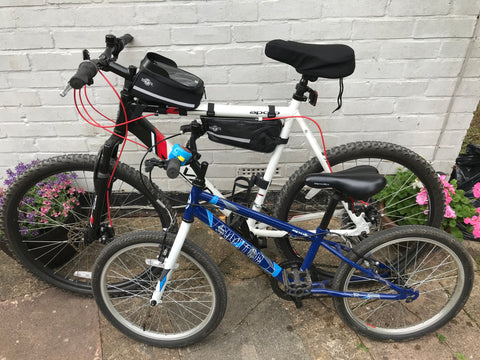 BTR bike phone bag and bike frame bag on adult bicycle along side child bicycle