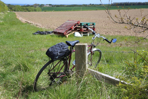 BR rear rack bicycle pannier bag on bicycle in field