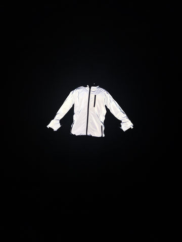 BTR reflective high viz jacket being worn in the dark reflecting brilliantly