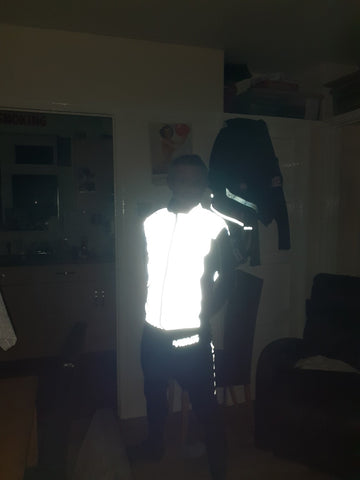 Be Totally Reflective Gilet shown in the dark from BTR