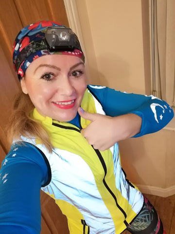 Claire our instagram ambassador wearing our gilet in high vis yellow and reflective from BTR