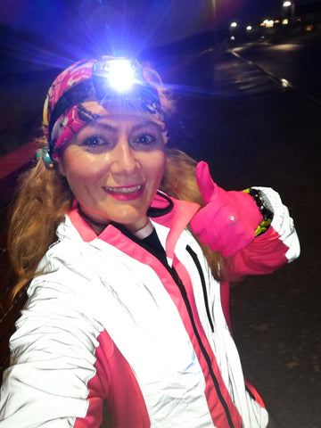Claire wearing a BTR High Visibility Reflective Jacket in pink