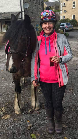 BTR pink reflective high vis jacket worn by a lady horse rider