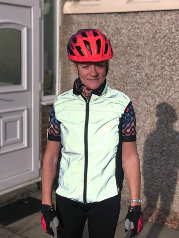 BTR reflective high vis cycling and running gilet being worn in the day by a lady