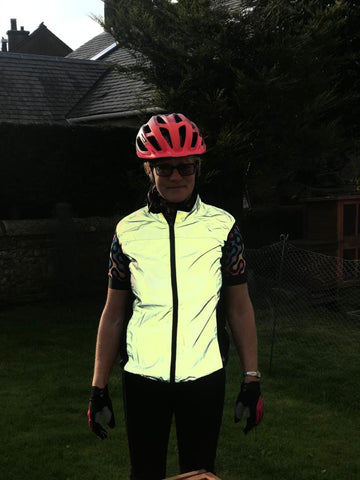 BTR reflective cycling gilet reflecting in the dark being worn by a woman