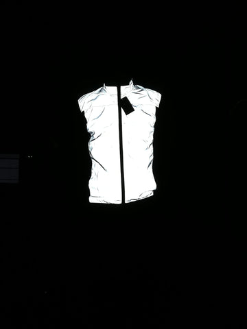 BTR reflective silver high vis running and cycling gilet worn by man in the dark