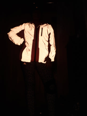 BTR high vis pink reflective cycling and running jacket reflecting in the dark worn by a woman