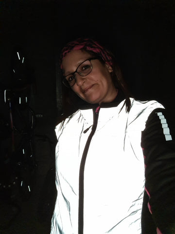 Renata wearing our Be Totally Reflective gilet in the night time - customer photos from BTR
