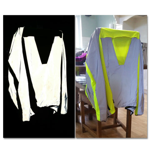 High vis yellow jacket with highly reflective panels shown in the dark with photo flash, customer review image