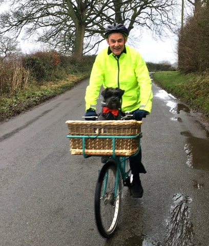 BTR high vis jacket shown on a bike - with a dog in a basket! Be seen