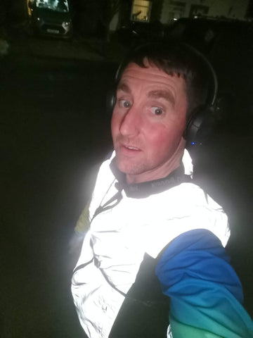 BTR reflective running high visibility gilet being worn by a man demonstrating how high viz it is at night