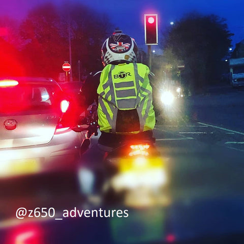 Waterproof and high visibility and reflective rucksack cover on a motorbike - customer image
