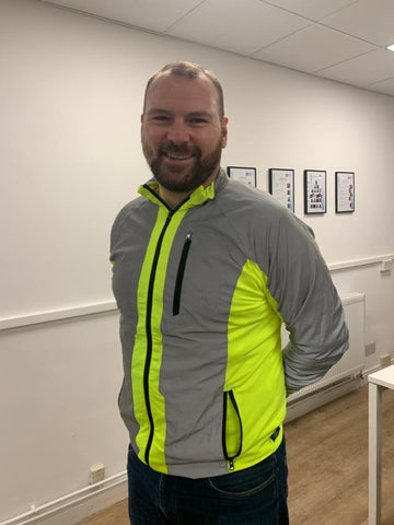 BTR jacket in high vis yellow & reflective panels worn by a cyclist, customer photo