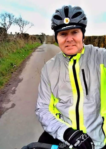 BTR hi viz yellow and reflective silver jacket shown worn on a bike ride - be seen