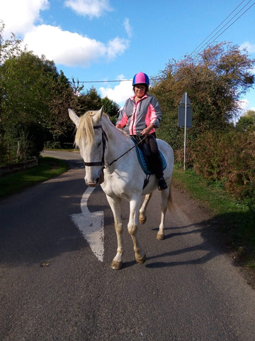 BTR pink reflective high vis jacket worn by lady riding a horse