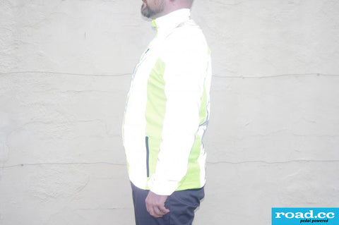 BTR high vis & reflective cycling / running jacket shown on side view from road.cc review- shown reflective panels glowing bright