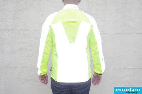 BTR high vis & reflective cycling / running jacket shown worn road.cc review- back view of it reflectiving