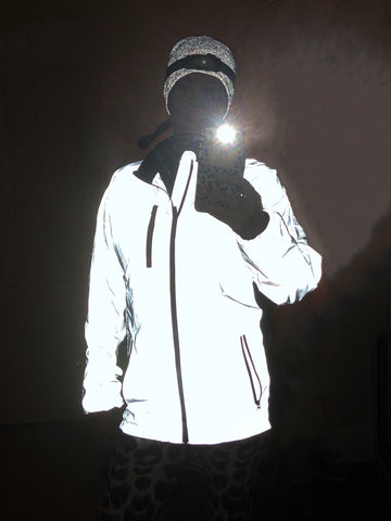 BTR high viz reflective running jacket worn by lady in the dark