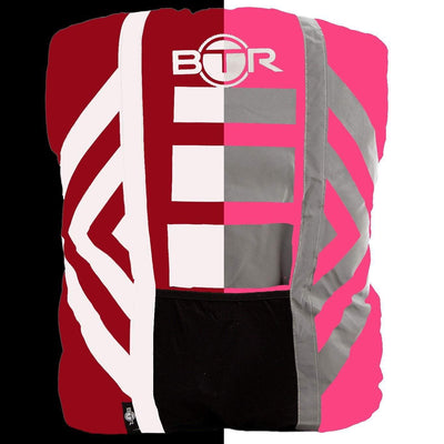 Pink hi vis waterproof backpack cover with reflective tape day and night half and half image