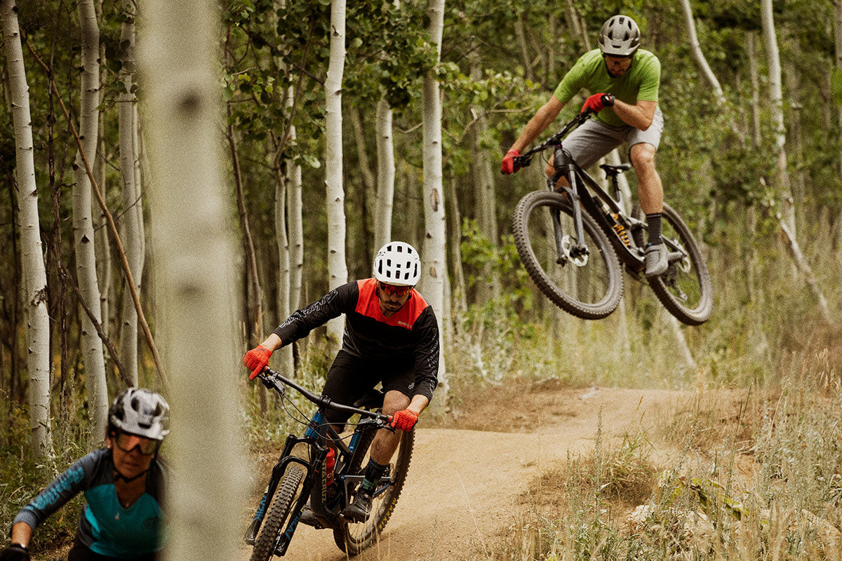 Mountain bikers getting rad on a trail
