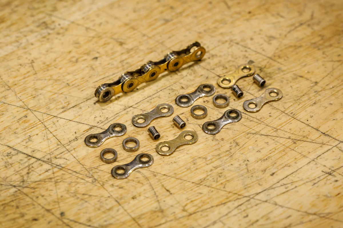 Bike chain links plates rollers and pins